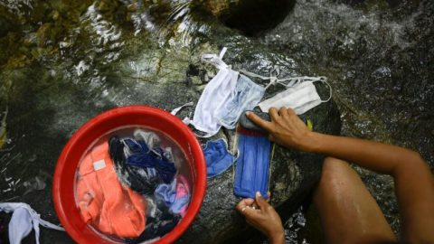 Venezuelan citizens draw water from any source available amid COVID crisis